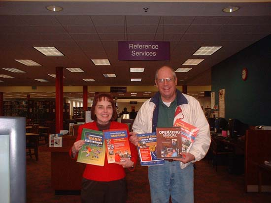 NFARL's Jim Stafford presents gift books to Ocoee Branch Library
